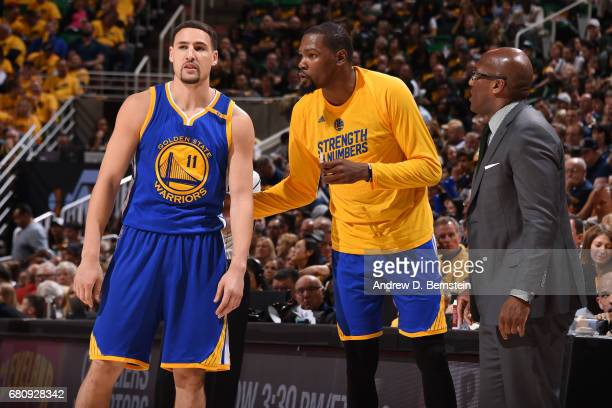 Klay Thompson Kevin Durant and Mike Brown of the Golden State Warriors talk in Game Three of the Western Conference Semifinals against the Utah Jazz...
