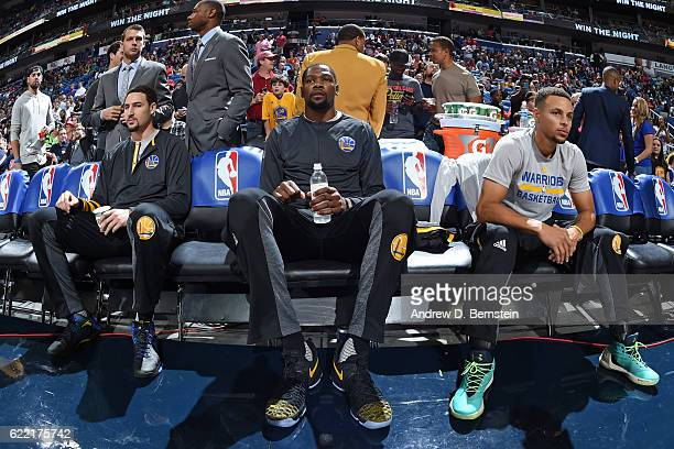Klay Thompson Kevin Durant and Stephen Curry of the Golden State Warriors prepare before a game against the New Orleans Pelicans at Smoothie King...