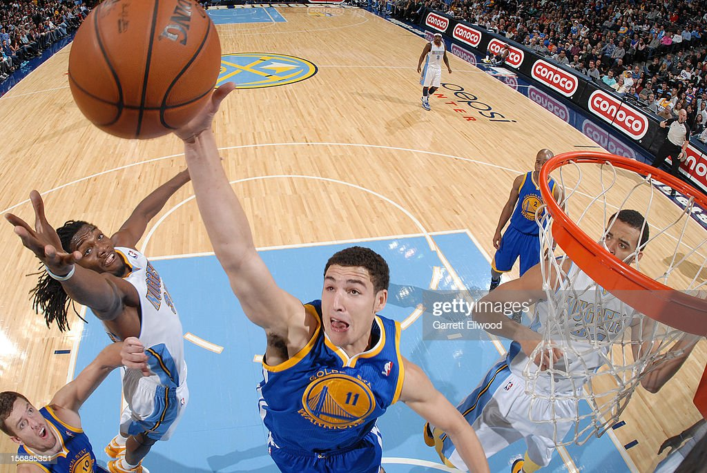 <a gi-track='captionPersonalityLinkClicked' href=/galleries/search?phrase=Klay+Thompson&family=editorial&specificpeople=5132325 ng-click='$event.stopPropagation()'>Klay Thompson</a> #11 of the Golden State goes up for a rebound against <a gi-track='captionPersonalityLinkClicked' href=/galleries/search?phrase=Kenneth+Faried&family=editorial&specificpeople=5765135 ng-click='$event.stopPropagation()'>Kenneth Faried</a> #35 of the Denver Nuggets on November 23, 2012 at the Pepsi Center in Denver, Colorado.