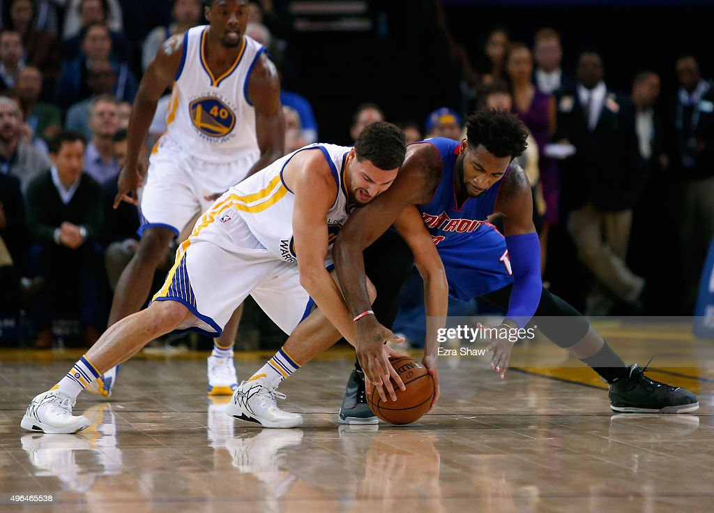 Klay Thompson #11 of the Golden State Warriors and Andre Drummond #0 of the Detroit Pistons go for a loose ball at ORACLE Arena on November 9, 2015 in Oakland, California.