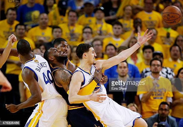 Klay Thompson of the Golden State Warriors and LeBron James of the Cleveland Cavaliers get tangled up in the fourth quarter during Game Two of the...