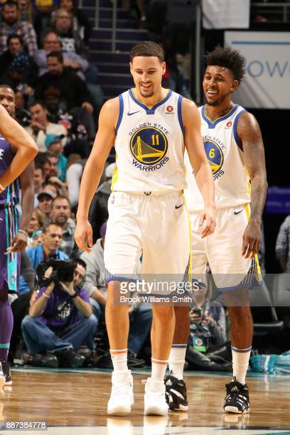Klay Thompson of the Golden State Warriors and Nick Young of the Golden State Warriors react during the game against the Charlotte Hornets on...
