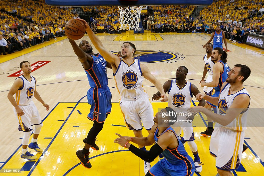 Klay Thompson of the Golden State Warriors blocks a shot by Serge Ibaka of the Oklahoma City Thunder during game two of the Western Conference Finals...