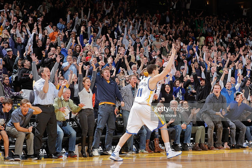 Klay Thompson #11 of the Golden State Warriors celebrates after making a go-ahead three-pointer against the Sacramento Kings on March 6, 2013 at Oracle Arena in Oakland, California.