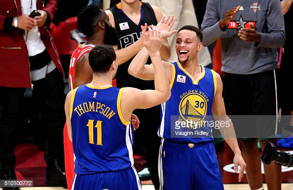 Klay Thompson of the Golden State Warriors celebrates with teammate Stephen Curry after winning the Foot Locker ThreePoint Contest during NBA AllStar...