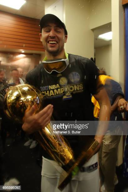 Klay Thompson of the Golden State Warriors celebrates with the Larry O'Brien Trophy in the locker room after winning the NBA Championsip in Game Five...