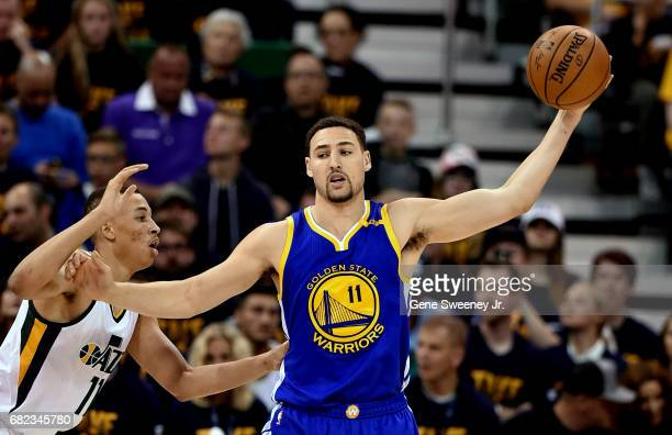 Klay Thompson of the Golden State Warriors controls the ball while being defended by Dante Exum of the Utah Jazz in Game Four of the Western...