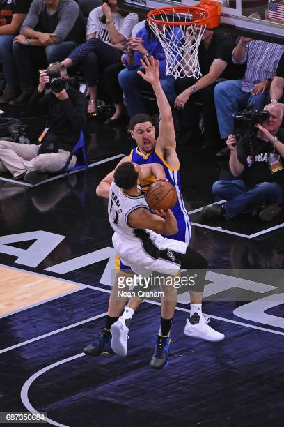 Klay Thompson of the Golden State Warriors defends Bryn Forbes of the San Antonio Spurs in Game Four of the Western Conference Finals during the 2017...