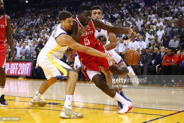Klay Thompson of the Golden State Warriors defends Clint Capela of the Houston Rockets during their NBA game at ORACLE Arena on October 17 2017 in...
