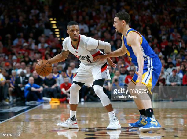 Klay Thompson of the Golden State Warriors defends Damian Lillard of the Portland Trail Blazers during Game Three of the Western Conference...