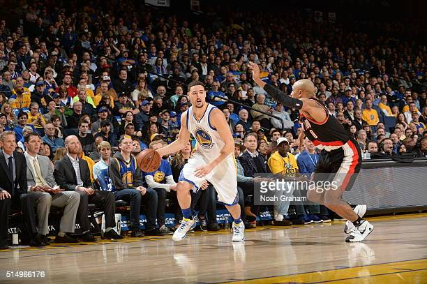 Klay Thompson of the Golden State Warriors dribbles the ball against the Portland Trail Blazers on March 11 2016 at Oracle Arena in Oakland...