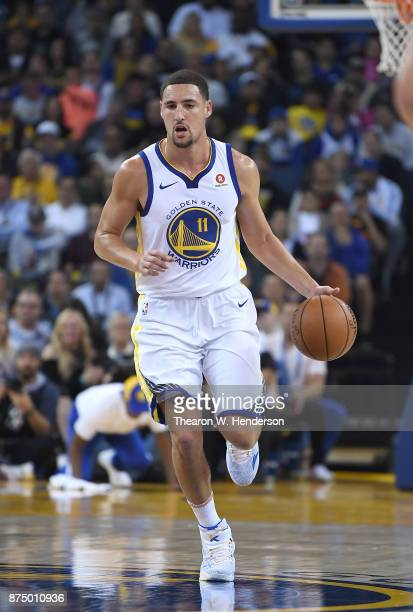 Klay Thompson of the Golden State Warriors dribbles the ball against the Philadelphia 76ers during an NBA basketball game at ORACLE Arena on November...