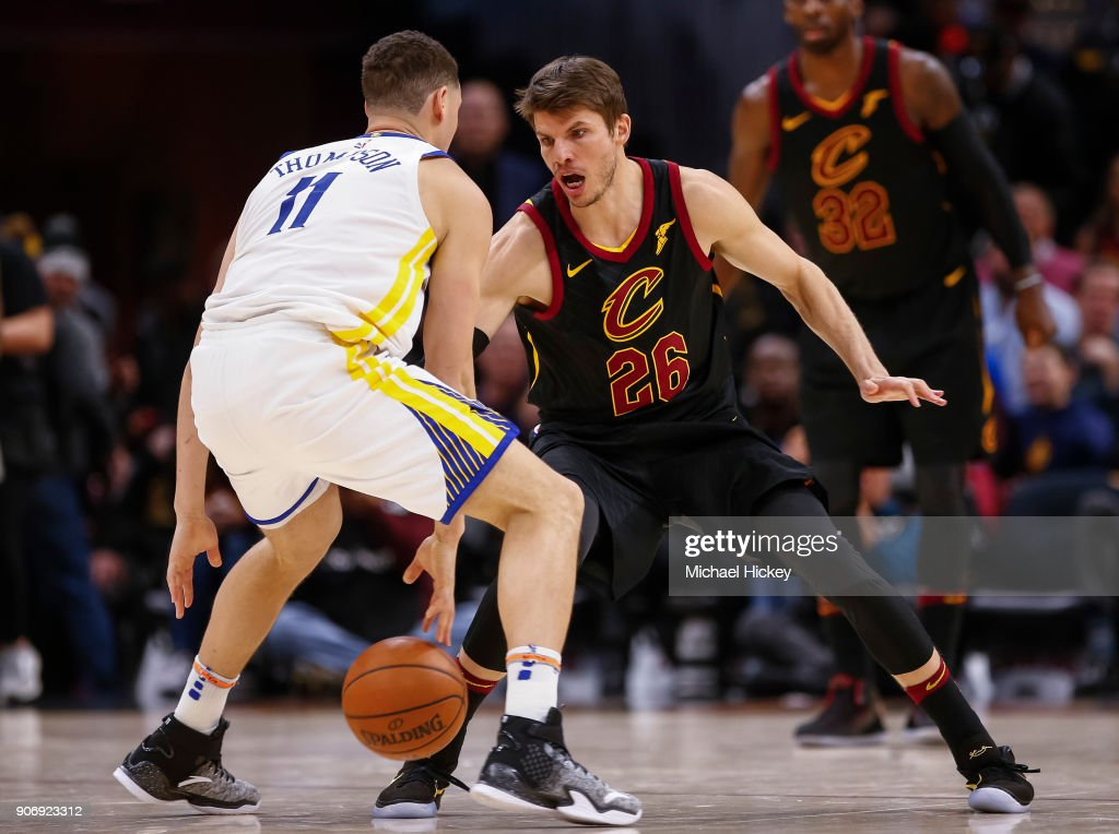 Klay Thompson #11 of the Golden State Warriors dribbles the ball against Kyle Korver #26 of the Cleveland Cavaliers at Quicken Loans Arena on January 15, 2018 in Cleveland, Ohio.