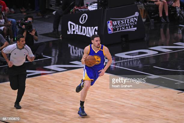 Klay Thompson of the Golden State Warriors dribbles the ball up court in Game Four of the Western Conference Finals against the San Antonio Spurs...