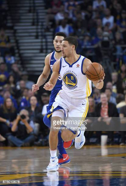 Klay Thompson of the Golden State Warriors dribbles the ball up court against the Philadelphia 76ers during an NBA basketball game at ORACLE Arena on...