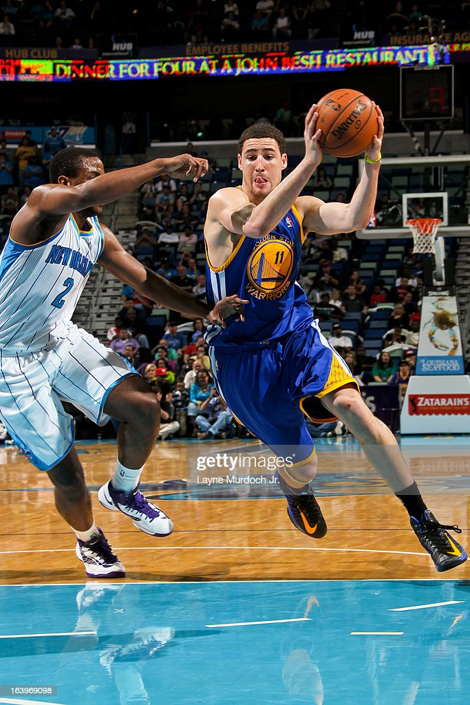 Klay Thompson #11 of the Golden State Warriors drives against Darius Miller #2 of the New Orleans Hornets on March 18, 2013 at the New Orleans Arena in New Orleans, Louisiana.