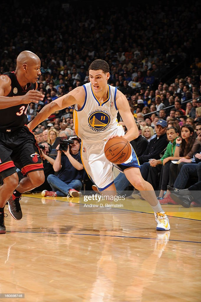 Klay Thompson #11 of the Golden State Warriors drives against Ray Allen #34 of the Miami Heat on January 16, 2013 at Oracle Arena in Oakland, California.