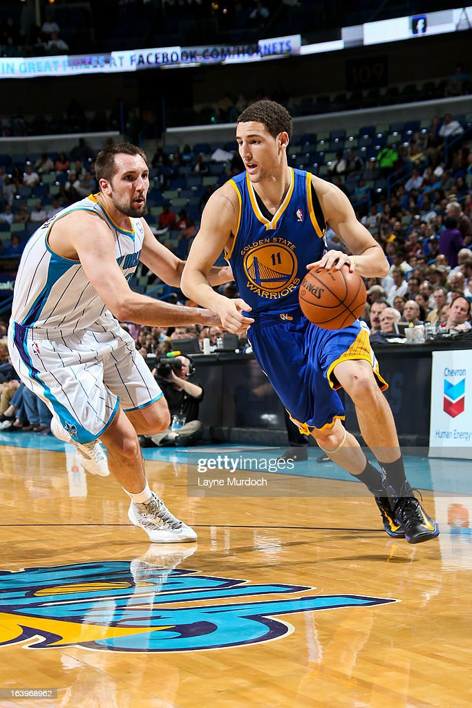 Klay Thompson #11 of the Golden State Warriors drives against Ryan Anderson #33 of the New Orleans Hornets on March 18, 2013 at the New Orleans Arena in New Orleans, Louisiana.