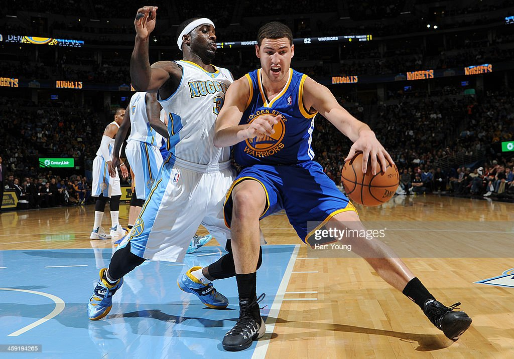 <a gi-track='captionPersonalityLinkClicked' href=/galleries/search?phrase=Klay+Thompson&family=editorial&specificpeople=5132325 ng-click='$event.stopPropagation()'>Klay Thompson</a> #11 of the Golden State Warriors drives against the Denver Nuggets on December 23, 2013 at the Pepsi Center in Denver, Colorado.