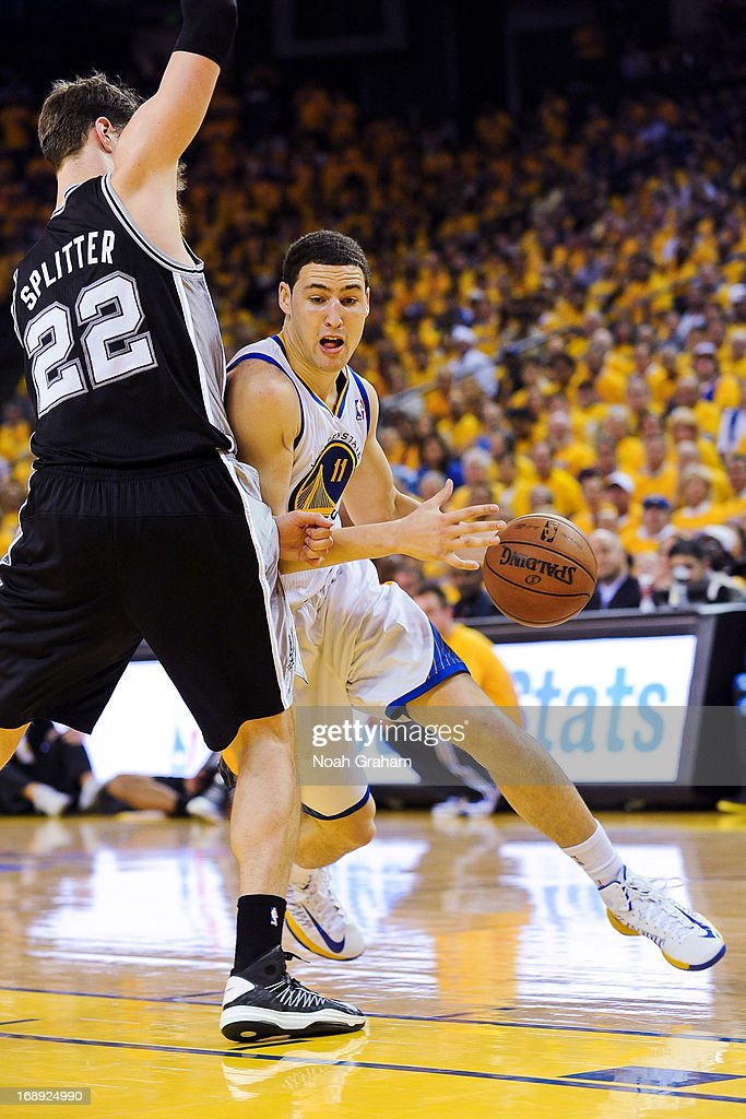 Klay Thompson #11 of the Golden State Warriors drives against Tiago Splitter #22 of the San Antonio Spurs in Game Six of the Western Conference Semifinals during the 2013 NBA Playoffs on May 16, 2013 at Oracle Arena in Oakland, California.