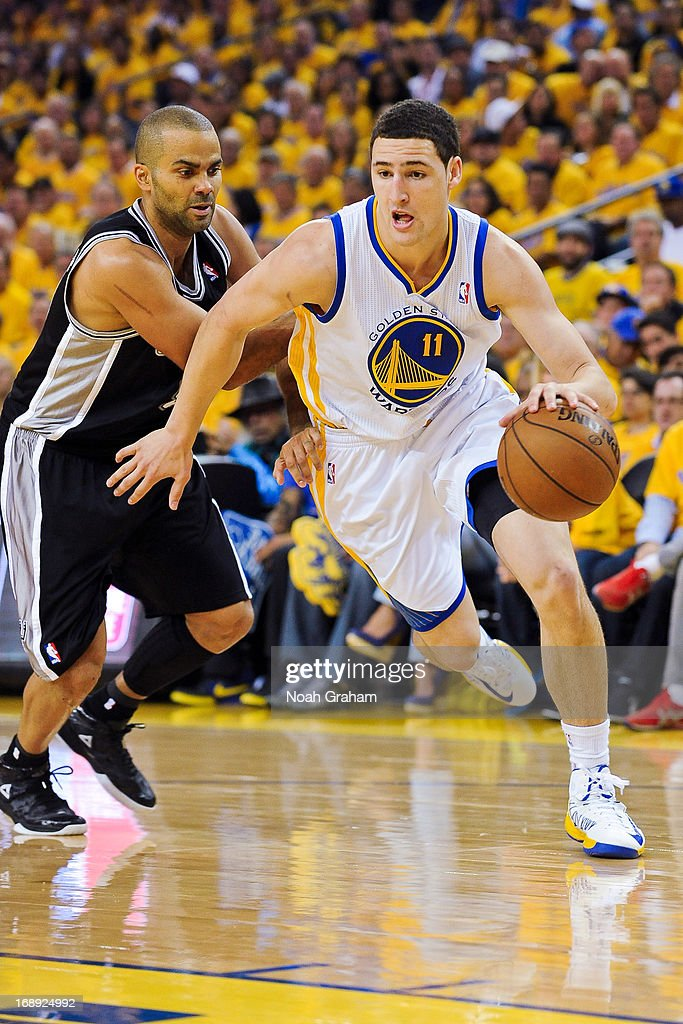 Klay Thompson #11 of the Golden State Warriors drives against Tony Parker #9 of the San Antonio Spurs in Game Six of the Western Conference Semifinals during the 2013 NBA Playoffs on May 16, 2013 at Oracle Arena in Oakland, California.