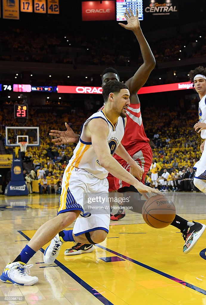 Klay Thompson of the Golden State Warriors drives on Clint Capela of the Houston Rockets in the fourth quarter in Game One of the Western Conference...