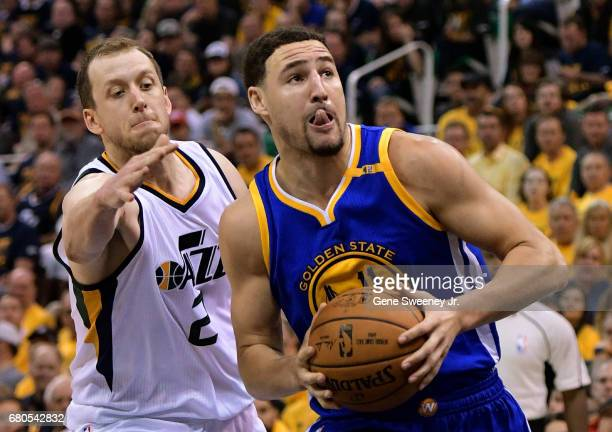 Klay Thompson of the Golden State Warriors drives past Joe Ingles of the Utah Jazz in the second half of their 12195 win in Game Four of the Western...