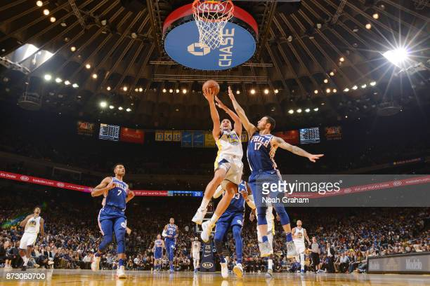 Klay Thompson of the Golden State Warriors drives to the basket against JJ Redick of the Philadelphia 76ers on November 11 2017 at ORACLE Arena in...