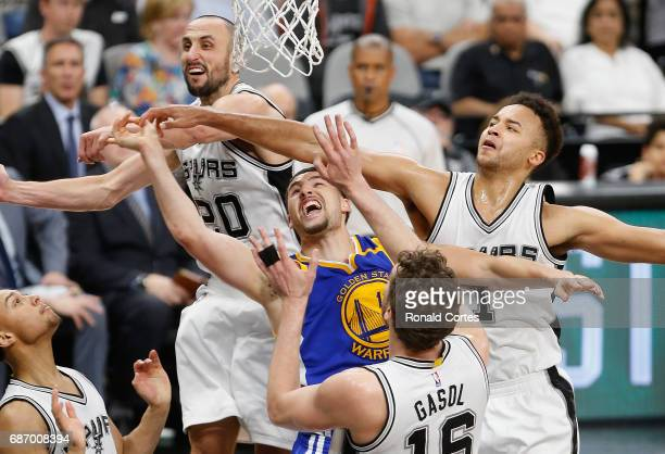 Klay Thompson of the Golden State Warriors drives to the basket against Manu Ginobili Kyle Anderson and Pau Gasol of the San Antonio Spurs in the...