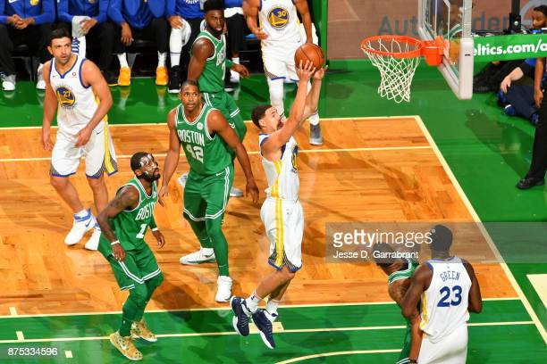 Klay Thompson of the Golden State Warriors drives to the basket Boston Celtics on November 16 2017 at the TD Garden in Boston Massachusetts NOTE TO...