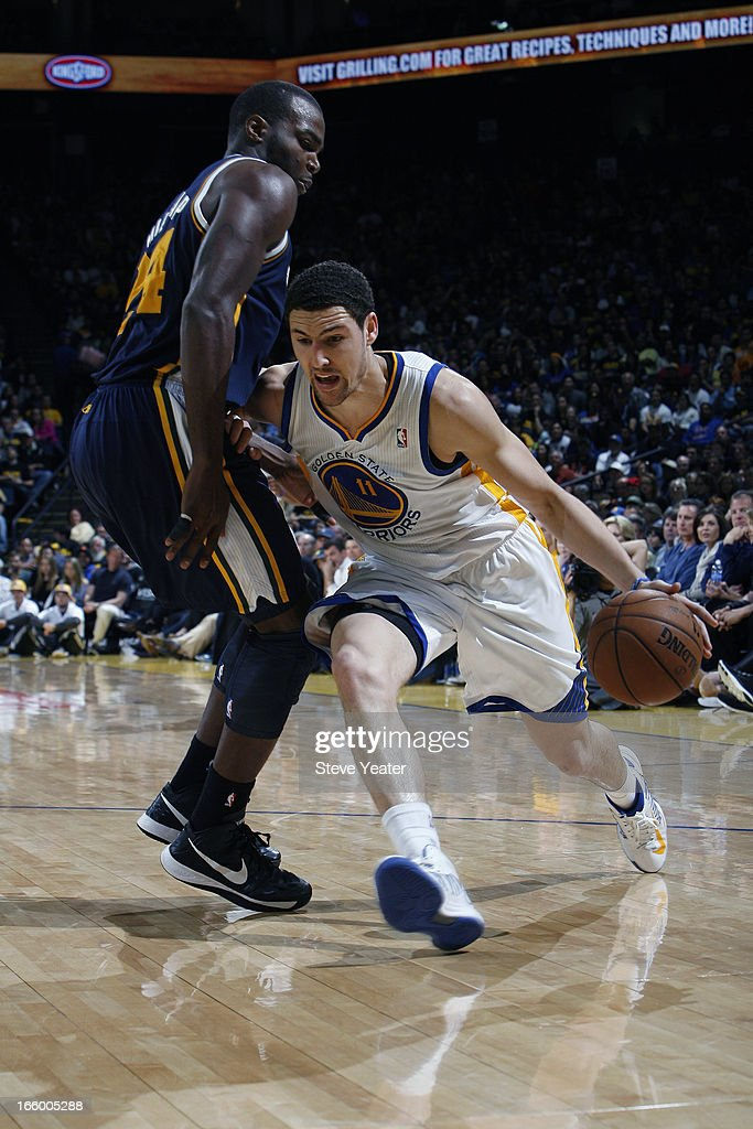 <a gi-track='captionPersonalityLinkClicked' href=/galleries/search?phrase=Klay+Thompson&family=editorial&specificpeople=5132325 ng-click='$event.stopPropagation()'>Klay Thompson</a> #11 of the Golden State Warriors drives to the basket against <a gi-track='captionPersonalityLinkClicked' href=/galleries/search?phrase=Paul+Millsap&family=editorial&specificpeople=880017 ng-click='$event.stopPropagation()'>Paul Millsap</a> #24 of the Utah Jazz on April 7, 2013 at Oracle Arena in Oakland, California.
