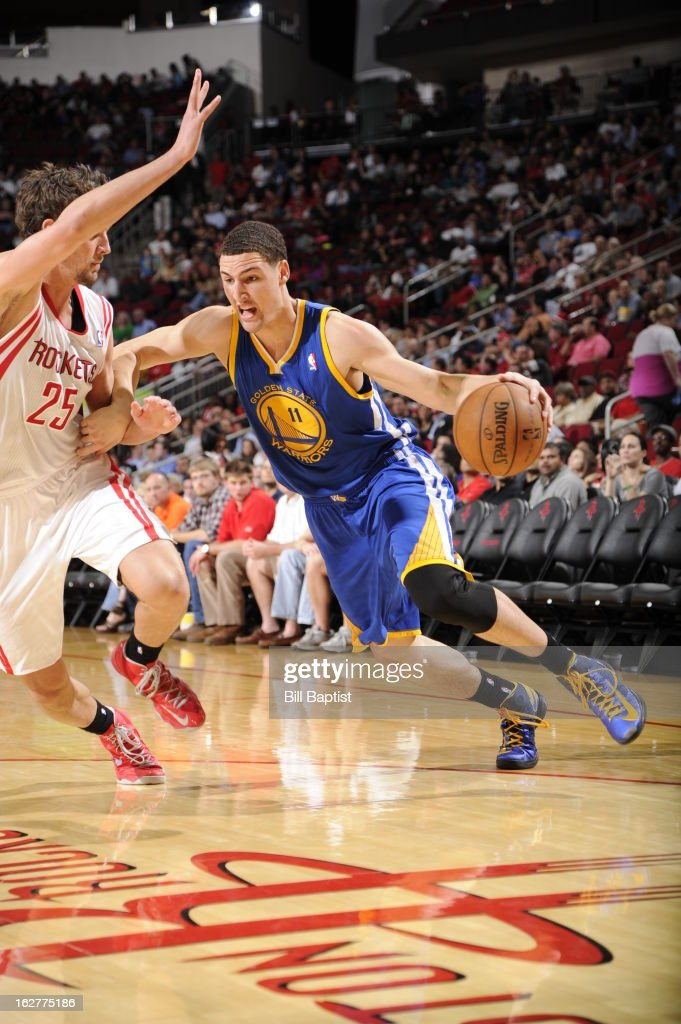 <a gi-track='captionPersonalityLinkClicked' href=/galleries/search?phrase=Klay+Thompson&family=editorial&specificpeople=5132325 ng-click='$event.stopPropagation()'>Klay Thompson</a> #11 of the Golden State Warriors drives to the basket against the Houston Rockets on February 5, 2013 at the Toyota Center in Houston, Texas.