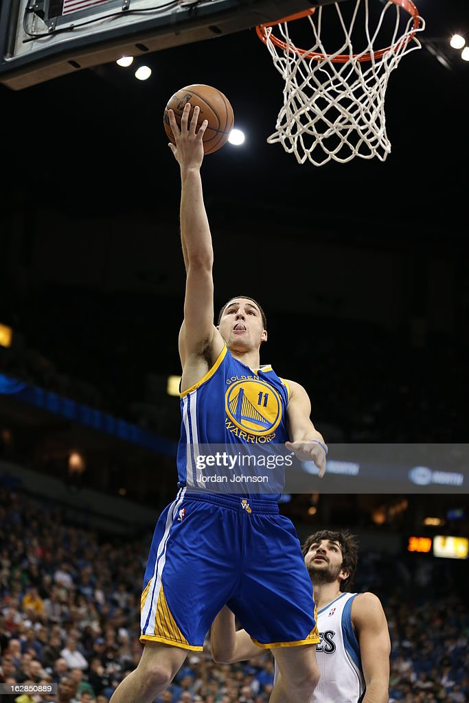 <a gi-track='captionPersonalityLinkClicked' href=/galleries/search?phrase=Klay+Thompson&family=editorial&specificpeople=5132325 ng-click='$event.stopPropagation()'>Klay Thompson</a> #11 of the Golden State Warriors drives to the basket against the Minnesota Timberwolves on February 24, 2013 at Target Center in Minneapolis, Minnesota.
