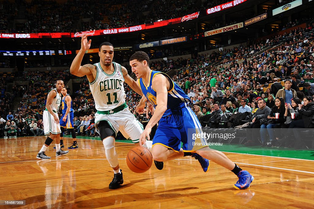 Klay Thompson #11 of the Golden State Warriors drives to the basket against the Boston Celtics on March 1, 2013 at the TD Garden in Boston, Massachusetts.