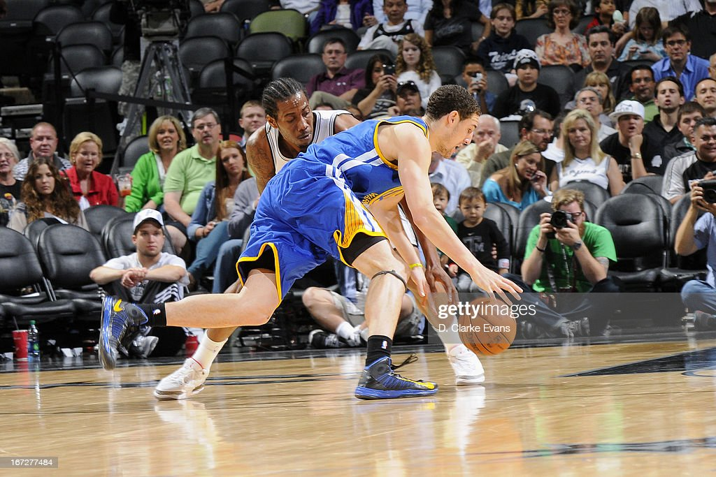 <a gi-track='captionPersonalityLinkClicked' href=/galleries/search?phrase=Klay+Thompson&family=editorial&specificpeople=5132325 ng-click='$event.stopPropagation()'>Klay Thompson</a> #11 of the Golden State Warriors drives to the basket against the San Antonio Spurs on March 20, 2013 at the AT&T Center in San Antonio, Texas.