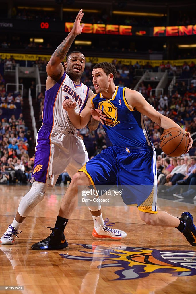 <a gi-track='captionPersonalityLinkClicked' href=/galleries/search?phrase=Klay+Thompson&family=editorial&specificpeople=5132325 ng-click='$event.stopPropagation()'>Klay Thompson</a> #11 of the Golden State Warriors drives to the basket against the Phoenix Suns on April 5, 2013 at U.S. Airways Center in Phoenix, Arizona.