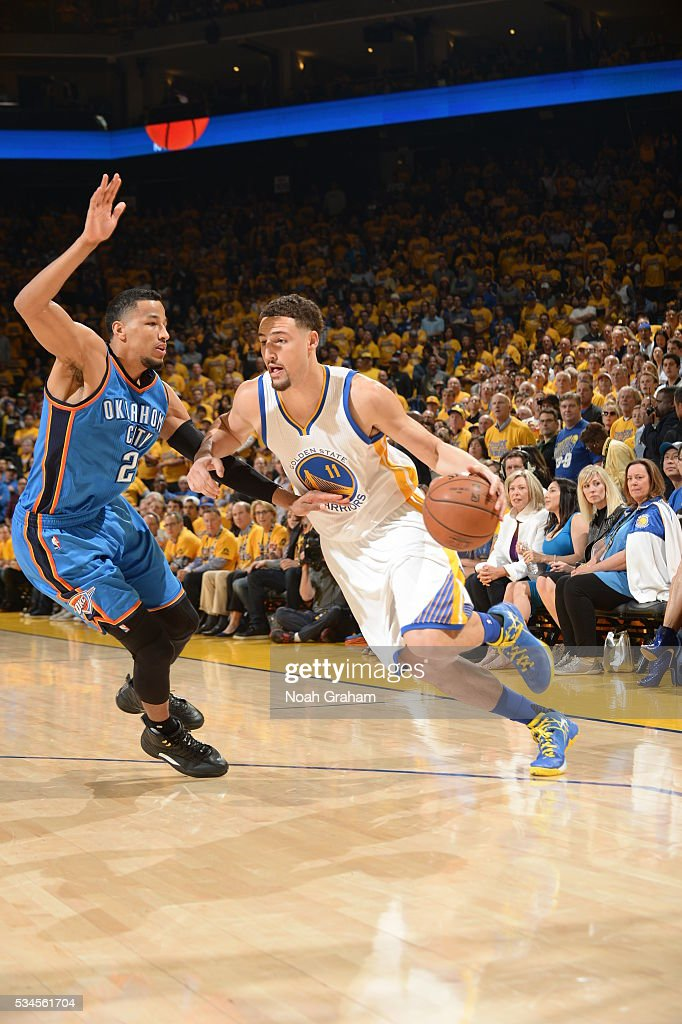 <a gi-track='captionPersonalityLinkClicked' href=/galleries/search?phrase=Klay+Thompson&family=editorial&specificpeople=5132325 ng-click='$event.stopPropagation()'>Klay Thompson</a> #11 of the Golden State Warriors drives to the basket against the Oklahoma City Thunder during Game Five of the Western Conference Finals during the 2016 NBA Playoffs on May 26, 2016 at ORACLE Arena in Oakland, California.
