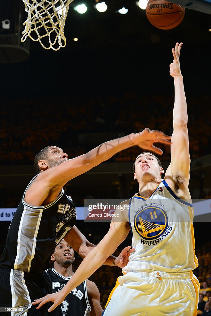 <a gi-track='captionPersonalityLinkClicked' href=/galleries/search?phrase=Klay+Thompson&family=editorial&specificpeople=5132325 ng-click='$event.stopPropagation()'>Klay Thompson</a> #11 of the Golden State Warriors drives to the basket against <a gi-track='captionPersonalityLinkClicked' href=/galleries/search?phrase=Tim+Duncan&family=editorial&specificpeople=201467 ng-click='$event.stopPropagation()'>Tim Duncan</a> #21 of the San Antonio Spurs in Game Three of the Western Conference Semifinals during the 2013 NBA Playoffs on May 10, 2013 at the Oracle Arena in Oakland, California.