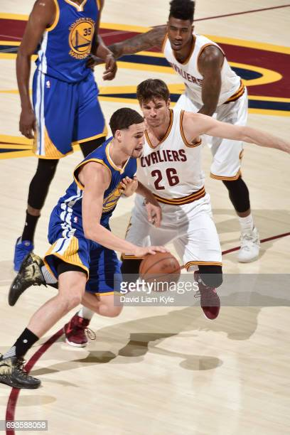 Klay Thompson of the Golden State Warriors drives to the basket while guarded by Kyle Korver of the Cleveland Cavaliers in Game Three of the 2017 NBA...
