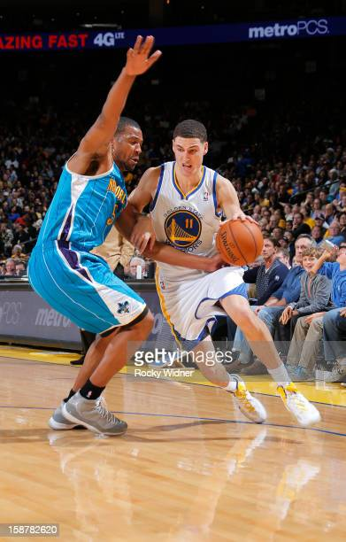 Klay Thompson of the Golden State Warriors drives to the hoop against Dominic McGuire of the New Orleans Hornets on December 18 2012 at Oracle Arena...
