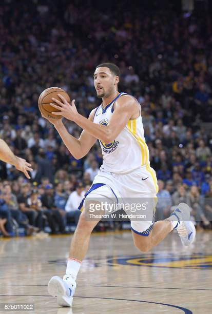 Klay Thompson of the Golden State Warriors drives towards the basket against the Philadelphia 76ers during an NBA basketball game at ORACLE Arena on...