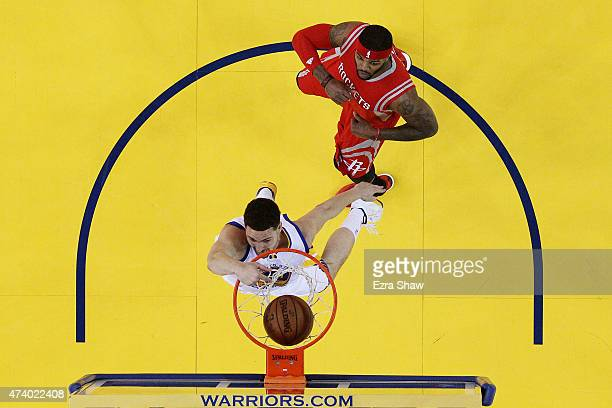 Klay Thompson of the Golden State Warriors dunks against Josh Smith of the Houston Rockets in the first half during Game One of the Western...