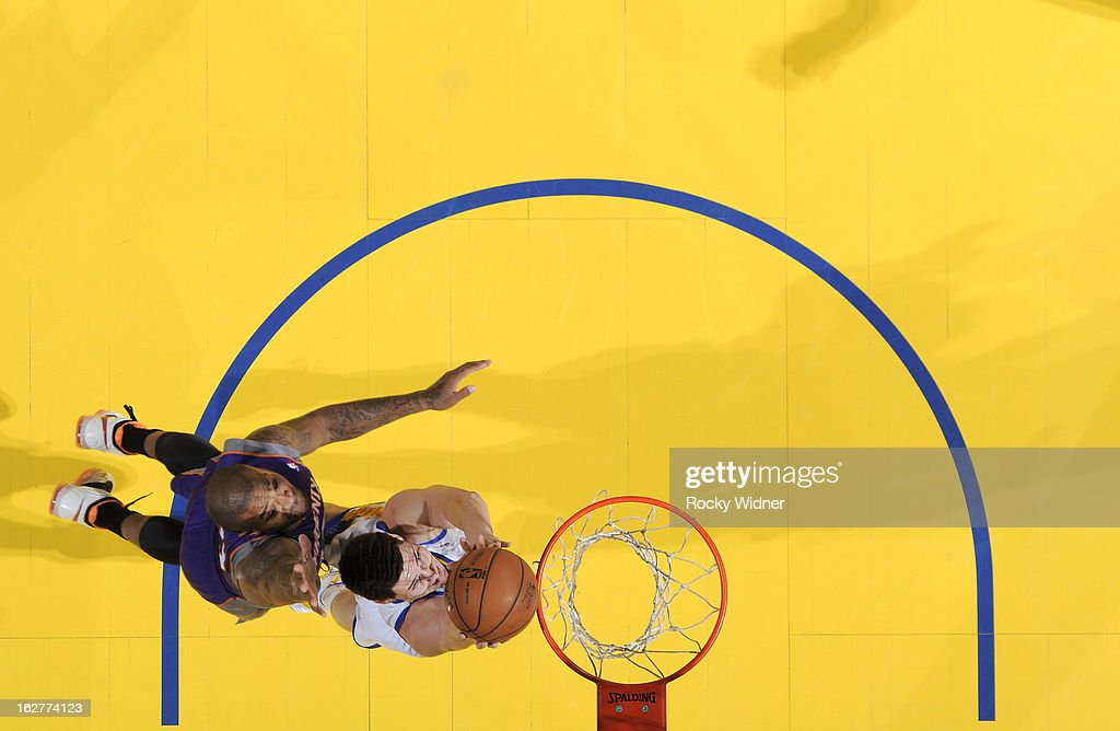 <a gi-track='captionPersonalityLinkClicked' href=/galleries/search?phrase=Klay+Thompson&family=editorial&specificpeople=5132325 ng-click='$event.stopPropagation()'>Klay Thompson</a> #11 of the Golden State Warriors dunks against <a gi-track='captionPersonalityLinkClicked' href=/galleries/search?phrase=P.J.+Tucker&family=editorial&specificpeople=227316 ng-click='$event.stopPropagation()'>P.J. Tucker</a> #17 of the Phoenix Suns on February 20, 2013 at Oracle Arena in Oakland, California.