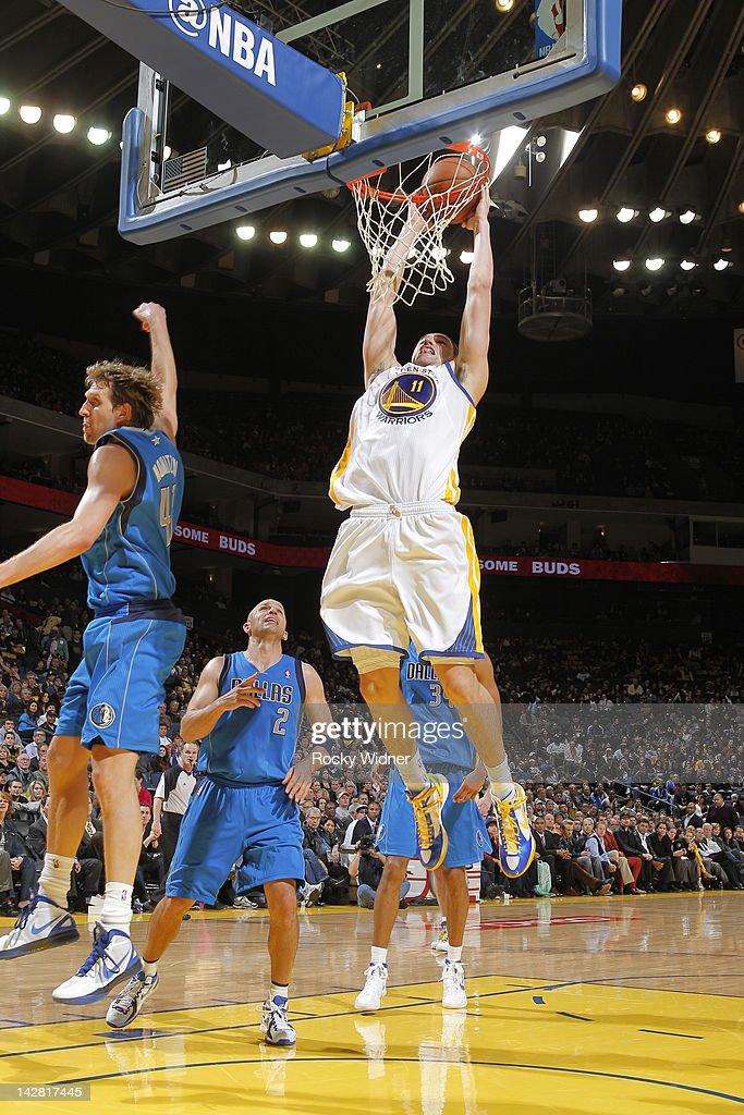 <a gi-track='captionPersonalityLinkClicked' href=/galleries/search?phrase=Klay+Thompson&family=editorial&specificpeople=5132325 ng-click='$event.stopPropagation()'>Klay Thompson</a> #11 of the Golden State Warriors dunks the ball against <a gi-track='captionPersonalityLinkClicked' href=/galleries/search?phrase=Dirk+Nowitzki&family=editorial&specificpeople=201490 ng-click='$event.stopPropagation()'>Dirk Nowitzki</a> #41 of the Dallas Mavericks on April 12, 2012 at Oracle Arena in Oakland, California.