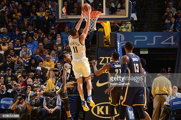 Klay Thompson of the Golden State Warriors dunks the ball against the Indiana Pacers on December 5 2016 at ORACLE Arena in Oakland California NOTE TO...