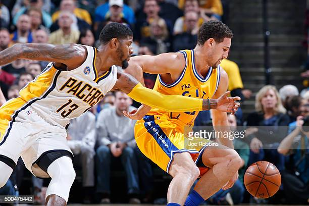 Klay Thompson of the Golden State Warriors goes for a loose ball against Paul George of the Indiana Pacers in the first half of the game at Bankers...
