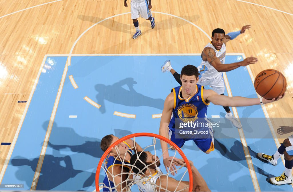 <a gi-track='captionPersonalityLinkClicked' href=/galleries/search?phrase=Klay+Thompson&family=editorial&specificpeople=5132325 ng-click='$event.stopPropagation()'>Klay Thompson</a> #11 of the Golden State Warriors goes to the basket against <a gi-track='captionPersonalityLinkClicked' href=/galleries/search?phrase=JaVale+McGee&family=editorial&specificpeople=4195625 ng-click='$event.stopPropagation()'>JaVale McGee</a> #34 of the Denver Nuggets on November 23, 2012 at the Pepsi Center in Denver, Colorado.