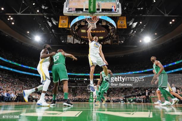 Klay Thompson of the Golden State Warriors goes to the basket against the Boston Celtics on November 16 2017 at the TD Garden in Boston Massachusetts...