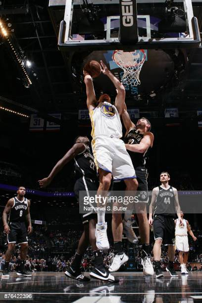 Klay Thompson of the Golden State Warriors goes to the basket against the Brooklyn Nets on November 19 2017 at Barclays Center in Brooklyn New York...