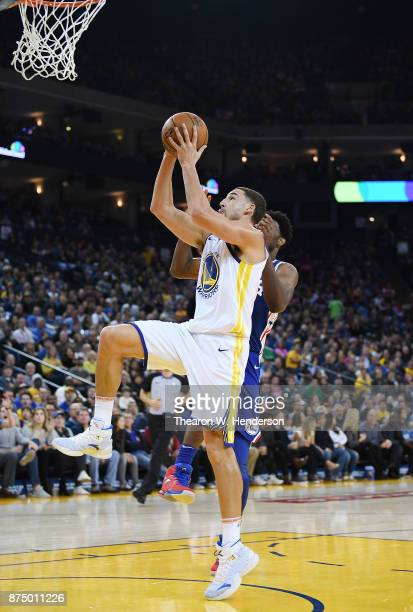 Klay Thompson of the Golden State Warriors goes up attempting to get his shot off in front of Joel Embiid of the Philadelphia 76ers during an NBA...